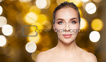 beautiful young woman face over white background