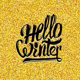 Hello winter typography on gold tinsel background