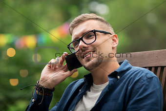 man calling on smartphone at summer garden party
