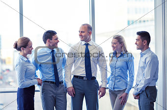 smiling business people talking in office