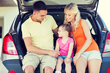 happy family with hatchback car outdoors