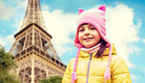 happy little girl over eiffel tower in paris