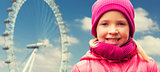 happy little girl portrait over ferry wheel