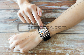 close up of hands with blog on smart watch screen