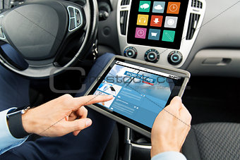 close up of man with tablet pc in car