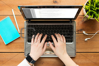 close up of woman or student typing on laptop