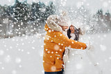 happy couple hugging and laughing in winter