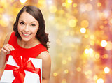 smiling woman in red dress with christmas gift