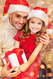 smiling father and daughter holding gift box