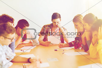 group of students with papers
