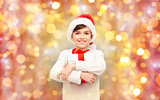 smiling happy boy in santa hat with gift box