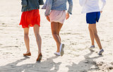 close up of women legs running on beach