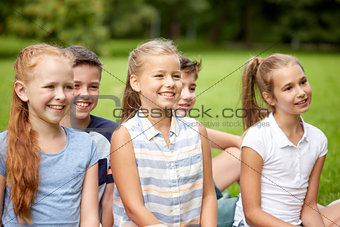 group of happy kids or friends outdoors