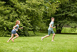 happy kids running and playing game outdoors