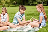 happy kids playing rock-paper-scissors game