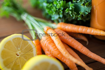 close up of carrot, lemon and lettuce