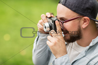 close up of man with camera shooting outdoors
