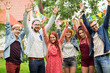 happy teen friends waving hands at summer garden