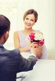 smiling woman recieving bouquet of flowers