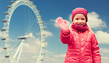 happy little girl waving hand over ferry wheel