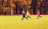 group of happy little kids running outdoors