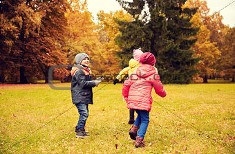 group of happy little kids having fun outdoors