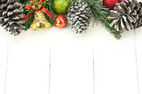 Christmas background with decorations on white wooden board.