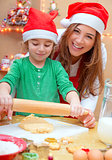 Mother with son doing Christmas cookies