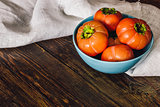 Persimmons in Blue Bowl