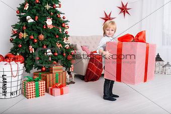 Boy with a big Christmas gift
