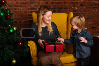 Mom gives a child Christmas gift