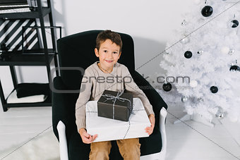 Boy with Christmas gifts