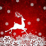 White paper deer on a red background