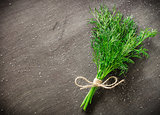 bunch of fresh dill on dark wood background