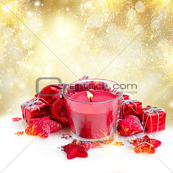 christmas candle with red decorations