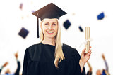 college graduation - woman wearing gown showing diploma