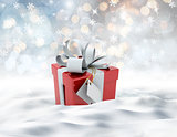 3D snowy landscape with Christmas gift nestled in snow