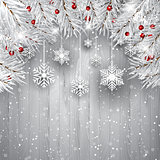 Hanging snowflakes with silver Christmas tree branches