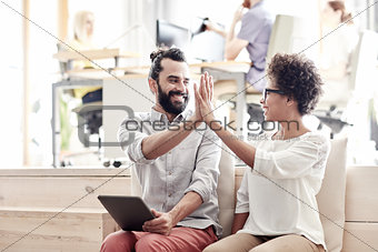 office workers with tablet pc making high five