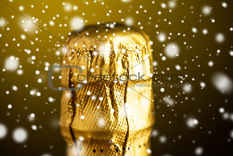 close up of champagne bottle cork wrapped in foil