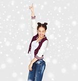 happy smiling pretty teenage girl dancing