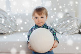 happy little baby boy with ball at home