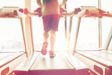 close up of male legs running on treadmill in gym