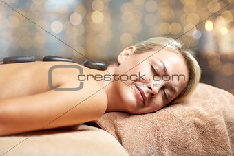 close up of woman having hot stone massage in spa