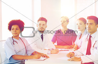 group of happy doctors on conference at hospital