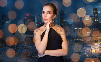 beautiful woman in black wearing diamond jewelry