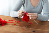 woman hands knitting with needles and yarn
