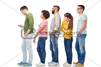 group of people in queue with smartphone