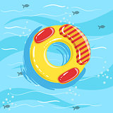 Toy Inflatable Ring With Blue Sea Water On Background