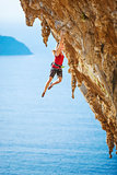 Young female rock climber on a cliff.